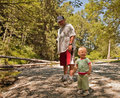Grandpa and Granddaughter Enjoy Fun At Creek Royalty Free Stock Photos
