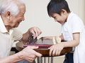 Grandpa and grandson asian playing chess Royalty Free Stock Image