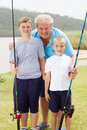 Grandpa grandsons fishing Stock Photography