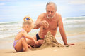 Grandpa Little Blond Girl Boy Build Sand Castle on Beach Royalty Free Stock Photo