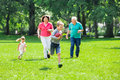 Grandparent And Grandchildren Playing Rugby In The Park