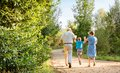 Grandparents and grandchild jumping outdoors Royalty Free Stock Photo