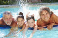 Grandparents With Grandchildren On Airbed In Swimming Pool Royalty Free Stock Photo