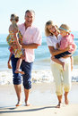 Grandparents And Grandchildren On Beach Royalty Free Stock Photos