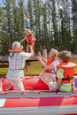 Grandparents And Grandchildren Enjoying Boat Trip On Lake Royalty Free Stock Photo
