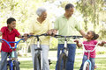 Grandparents With Grandchildren Riding Bikes Royalty Free Stock Images