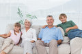 Grandparents and grandchildren sitting on couch Royalty Free Stock Photo