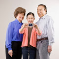 Grandparents and granddaughter posing Royalty Free Stock Images