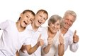 Grandparents with grandkids showing thumbs up on white background Stock Photo