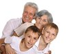Grandparents with grandkids on white background Royalty Free Stock Images