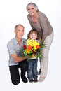 Grandparents and grandson stood by their Royalty Free Stock Image