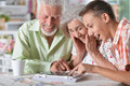 stock image of  Grandparents with grandson using laptop