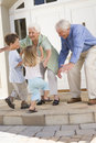 Grandparents welcoming grandchildren Stock Images