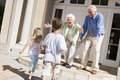 Grandparents welcoming grandchildren Royalty Free Stock Photo