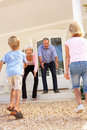 Grandparents Welcoming Grandchildren On Visit Royalty Free Stock Photo