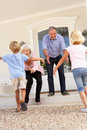 Grandparents Welcoming Grandchildren On Visit Stock Image