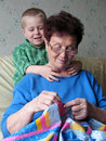 Grandson and grandmother at home Stock Photography