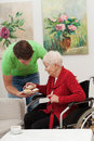 Grandson s care is caring for his disabled grandmother Stock Photos