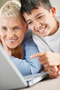 Grandson teaching grandmother about laptop Stock Image