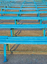 Grandstand old stadium empty wooden benches of blue color are on Stock Photo