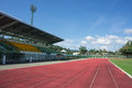 Grandstand race track football field and blue sky with Royalty Free Stock Photos