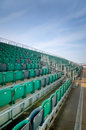 Grandstand seats empty seating at an outdoor sports venue Royalty Free Stock Photo