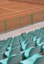 Grandstand seats and tennis court green Stock Images