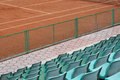 Grandstand seats and tennis court green Royalty Free Stock Photo