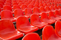 Grandstand stadium empty plastic chairs of red color are on Stock Image