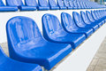 Grandstand stadium empty plastic chairs are on small depth of field Stock Photography