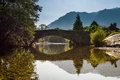 Grange bridge reflected at the village of over the river derwent in the lake district Royalty Free Stock Images