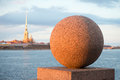 Granite ball close up in the light of the setting spring sun. Vasilievsky island, Saint Petersburg Royalty Free Stock Photo