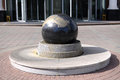 Granite ball mounted on a stand Royalty Free Stock Photo