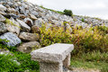 Granite Bench by Rock Wall Royalty Free Stock Photo