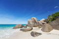 Granite boulders on the carana beach of mahe island seychelles seascape with large and blue summer sky view Royalty Free Stock Photography