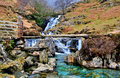 Granite Bridge over Cascading Waterfalls by the Watkins path on the Afon Cwm Llan, Snowdon Royalty Free Stock Photo