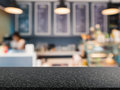 Granite counter top with bakery shop background Royalty Free Stock Photo