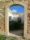 Granite door in old stone fortification, Caprera Island, Sardini Royalty Free Stock Photo