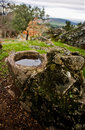 Granite parapet abandoned of a well at pedroso de acim village caceres spain Royalty Free Stock Photos