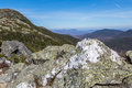 Granite rock mount mansfield is towering over vermont s forest landscape in october showing the bare at it s top Stock Images