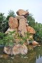 Granite rockery in pond water Royalty Free Stock Images