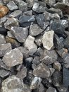 Granite rocks large and small put together the background Royalty Free Stock Image