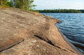 Granite rocky lake coastline rock of forest leningrad region russia Royalty Free Stock Photo