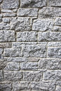 Granite stone wall blocks of bricks background grey speckled texture a Royalty Free Stock Image