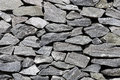 Granite wall of gray stones on sunshine day Stock Images