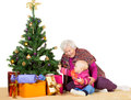 Granny and baby with Christmas tree Royalty Free Stock Photo