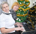 Granny and daughter prepare to Christmas Stock Image