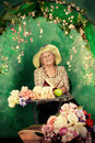 Granny garden beautiful older woman sitting in the among the flowers Royalty Free Stock Photos