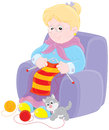 Granny knitting grandmother sits in an easychair and knits a striped scarf Royalty Free Stock Image