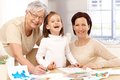 Granny mother and daughter smiling happy grandmother granddaughter drawing Stock Photos